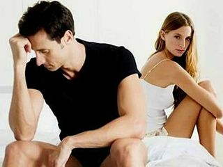 Unhappy-couple-in-bed